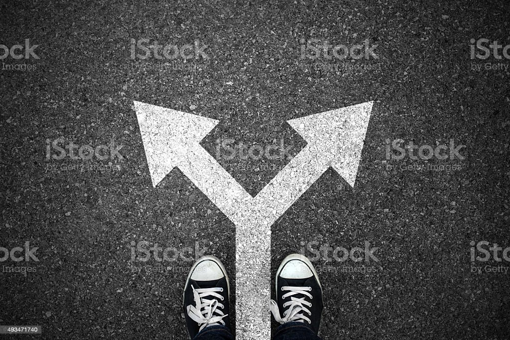 Walking direction on asphalt stock photo