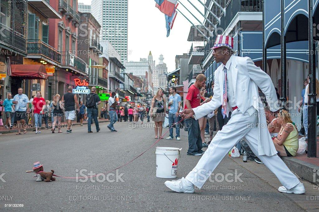 Walking dog on Bourbon Street stock photo