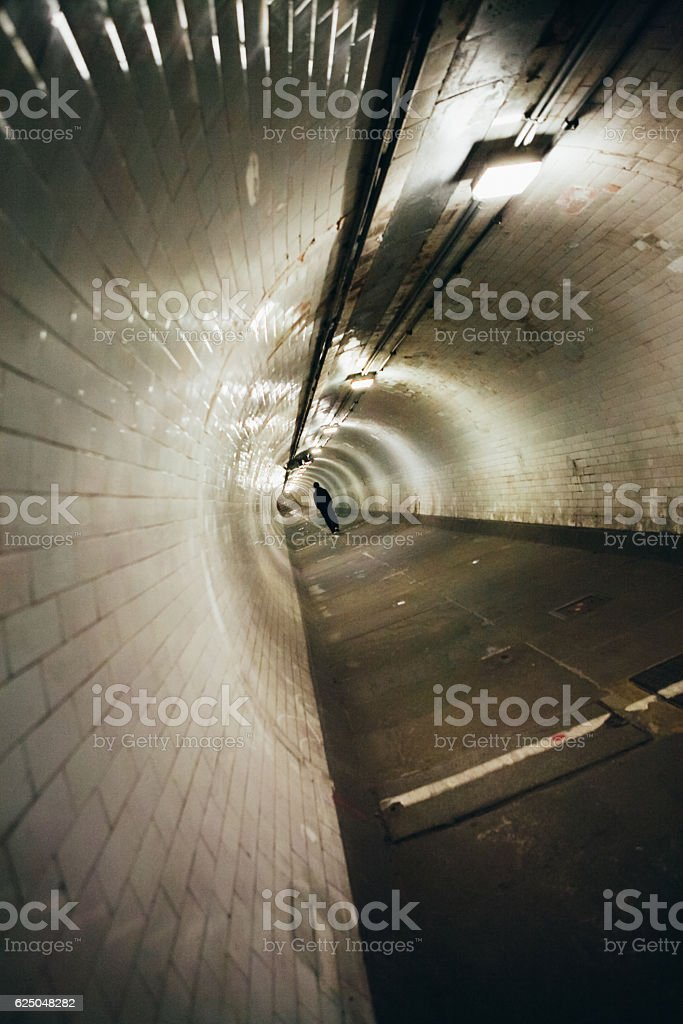 Walking down a tunnel stock photo