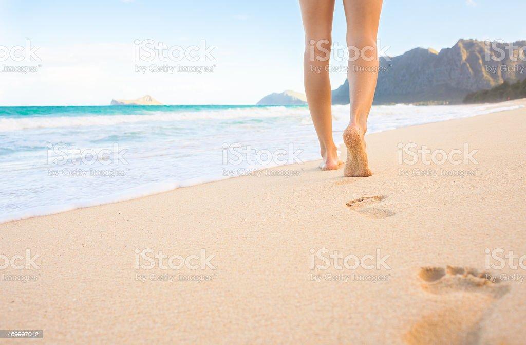 Walking down the beach stock photo