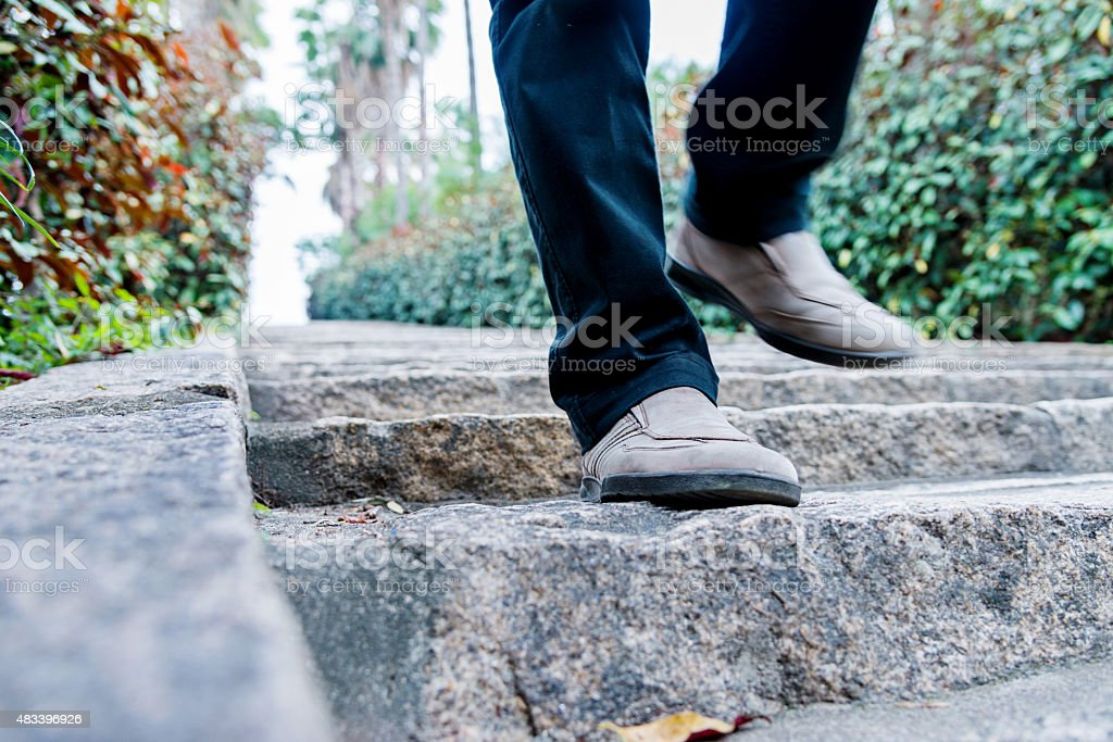walking down the stairs stock photo