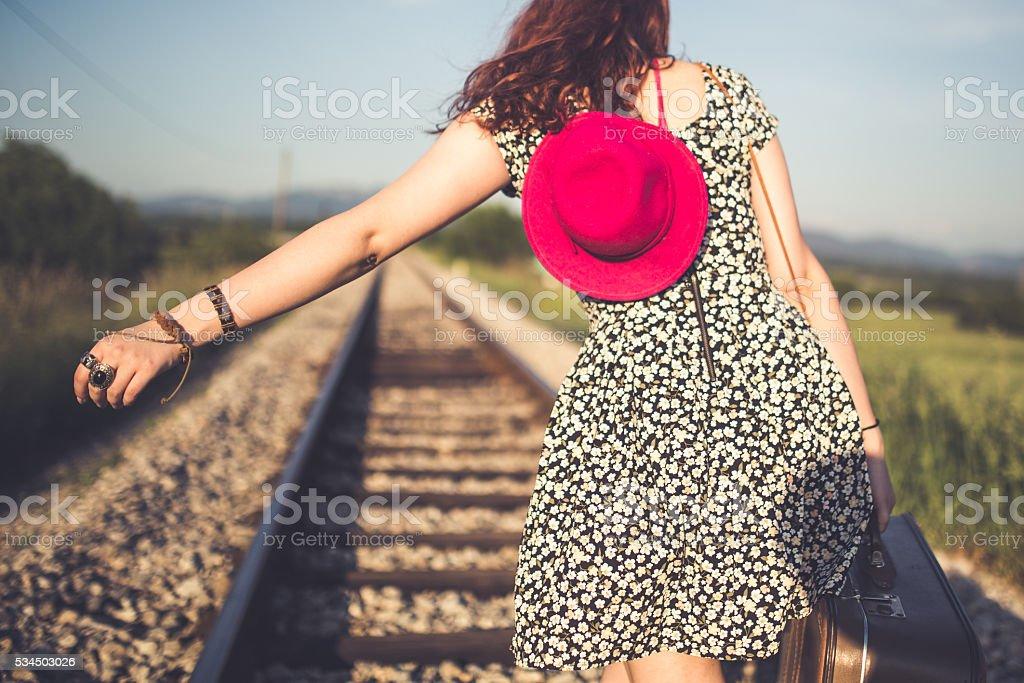 Walking down train tracks stock photo
