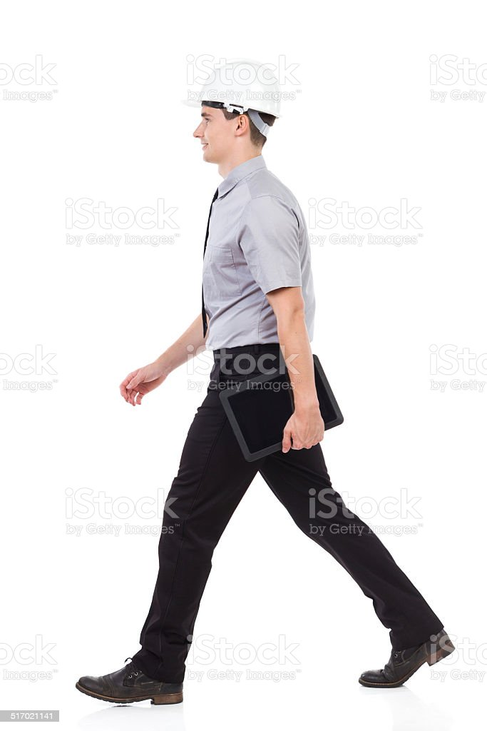 Walking engineer with tablet stock photo