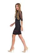 Walking Fashion Model In Black Dress