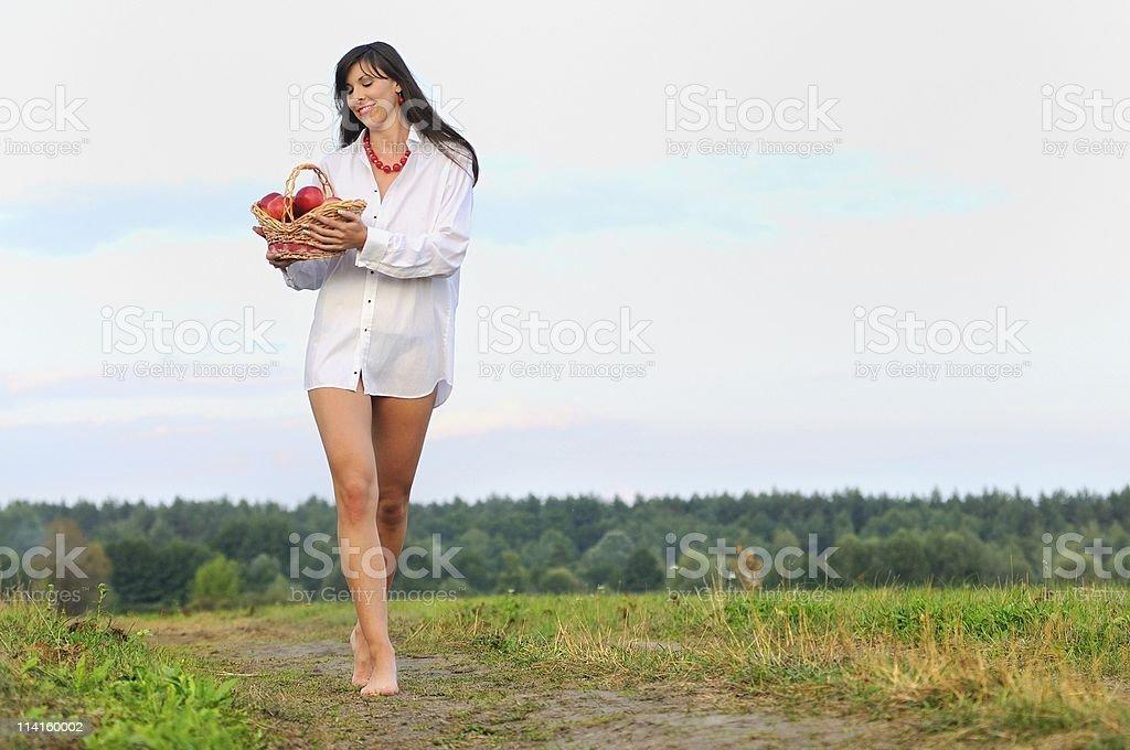 Walking girl witn basket royalty-free stock photo