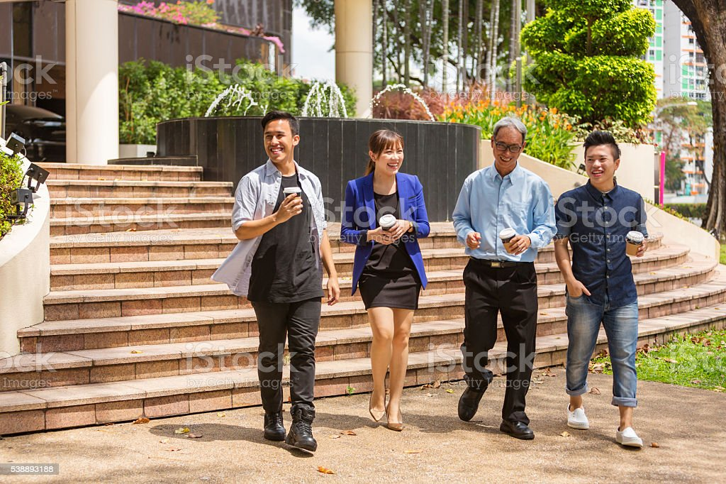 Walking Group of Business Start Up Entrepreneurs Meeting Outdoors stock photo