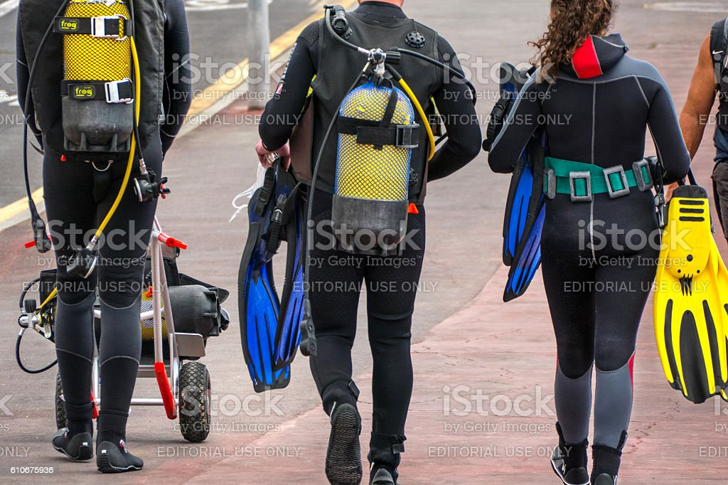 Walking group of divers stock photo