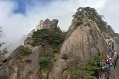 Walking hikers in the Huangshan mountains