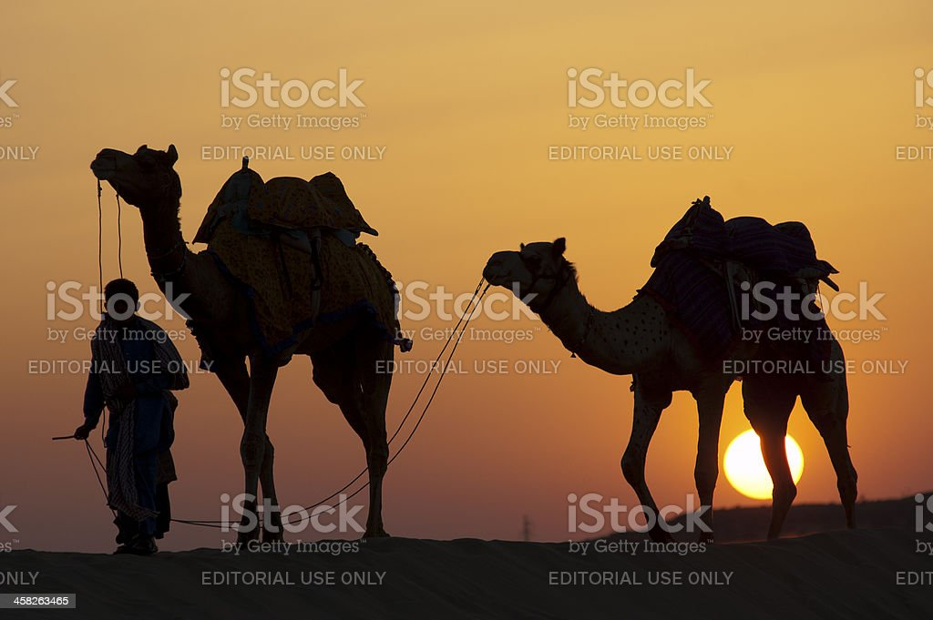 Walking home at sunset stock photo