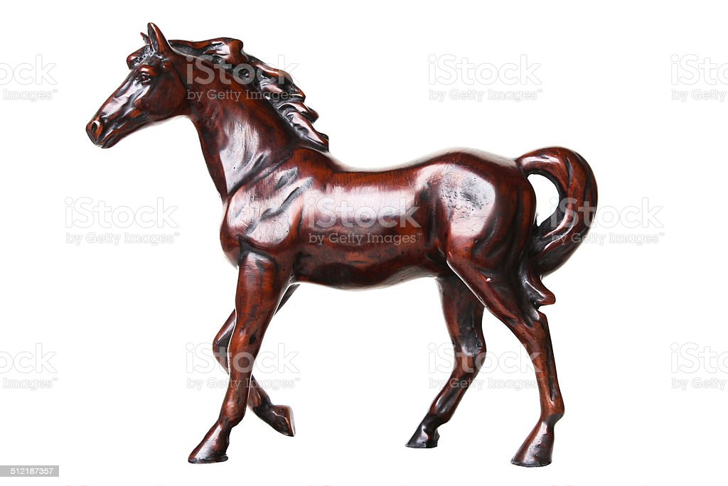 Walking horse sculpture isolated on white background stock photo