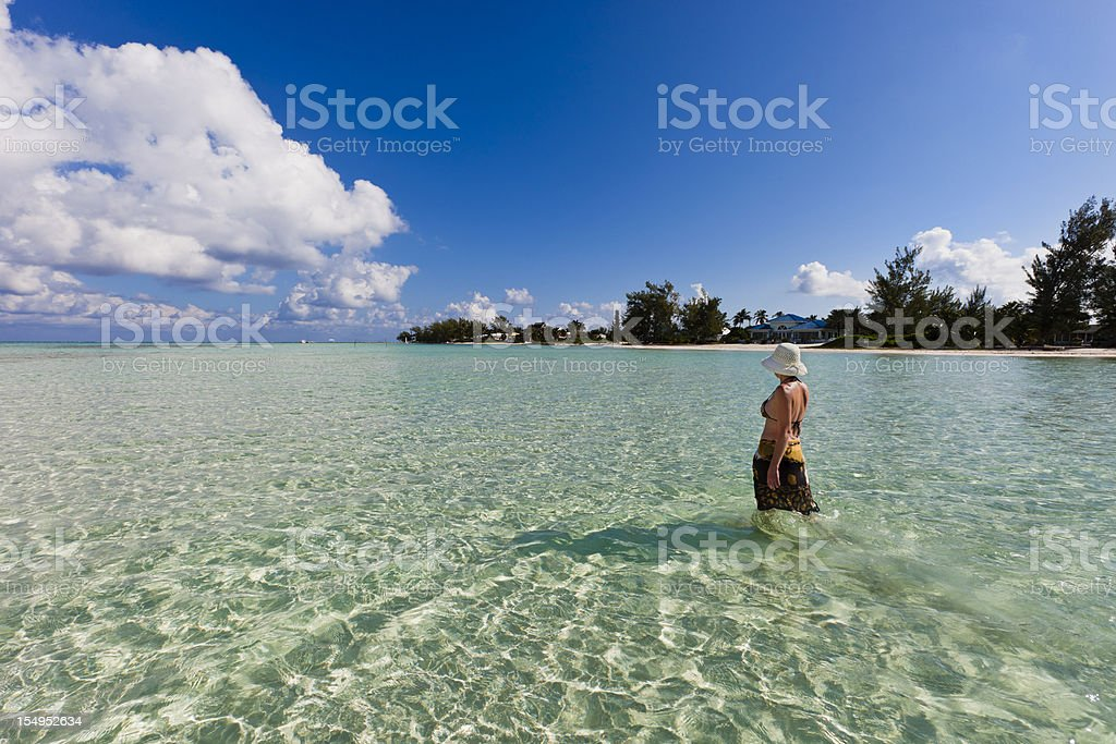 Walking In Clear Waters, Grand Cayman stock photo