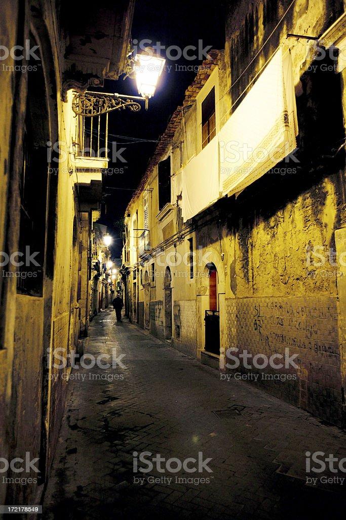 walking in dark alley stock photo