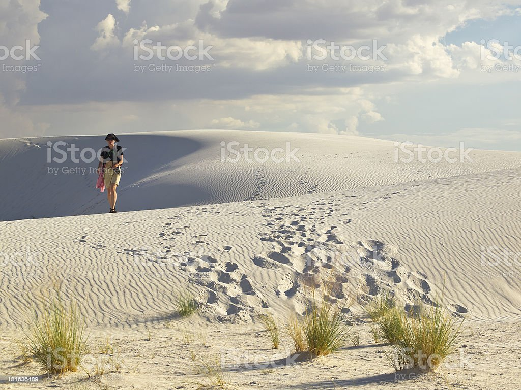 walking in desert stock photo