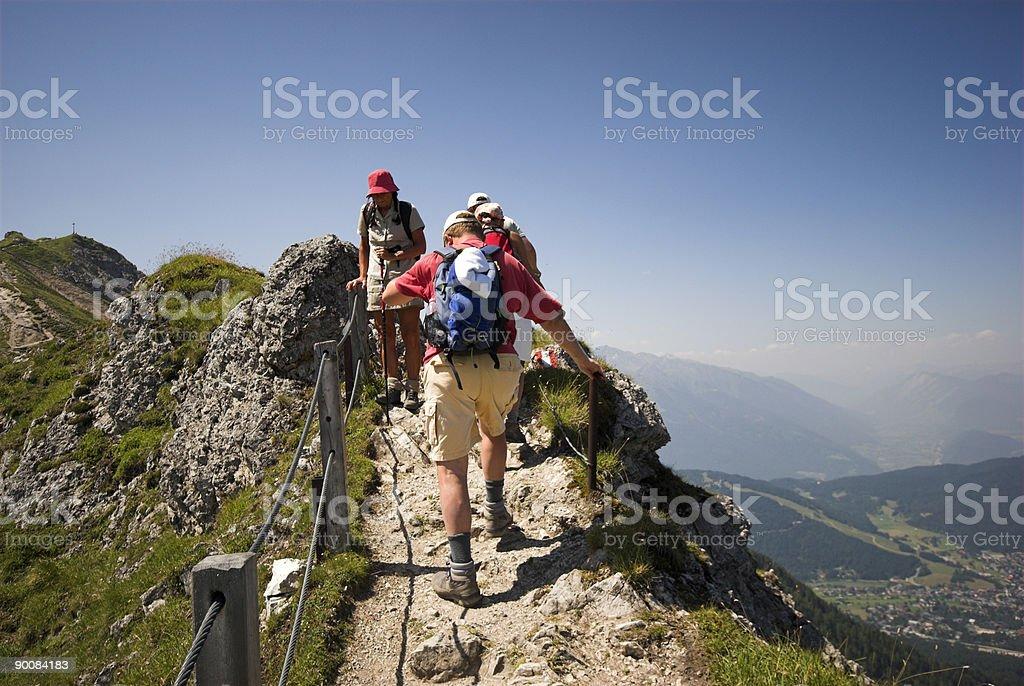 Walking in European Alps stock photo
