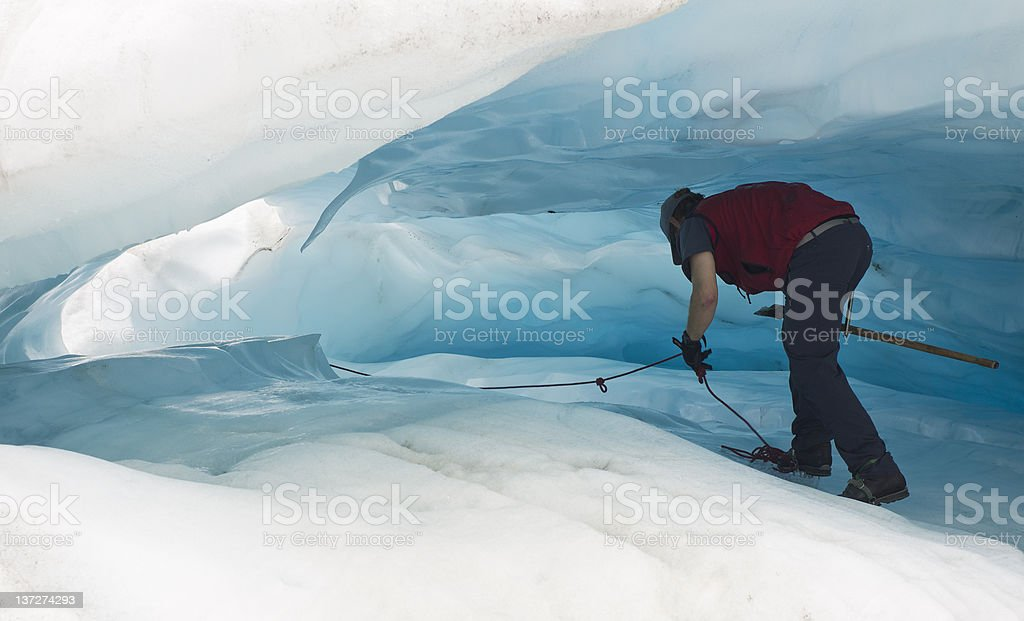 walking in ice cave stock photo