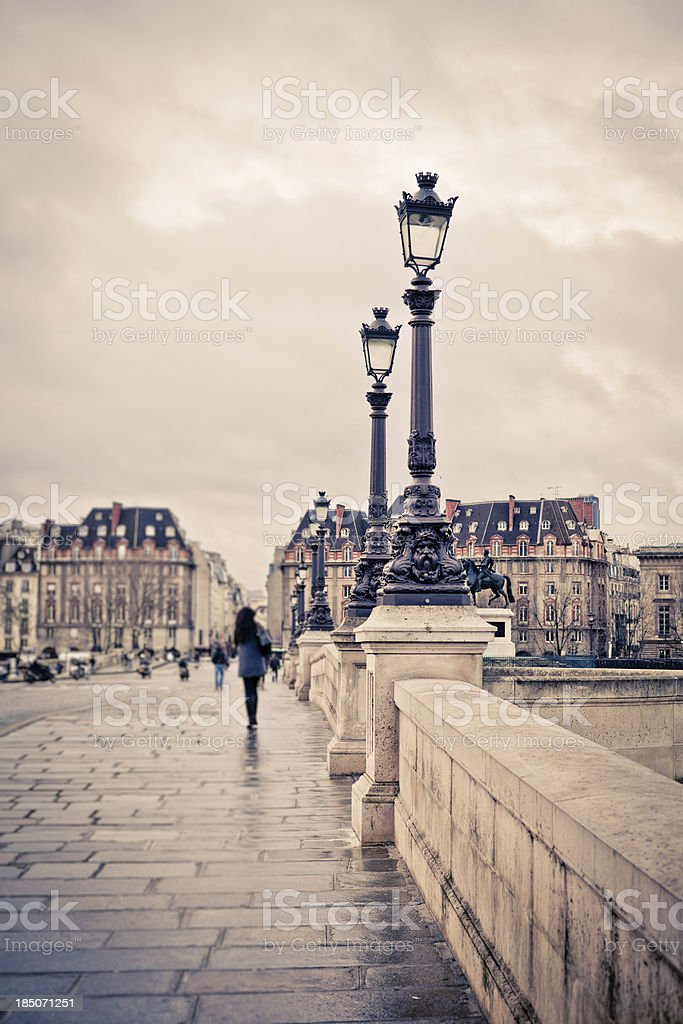 'Walking in Pont Neuf, Paris, France' stock photo