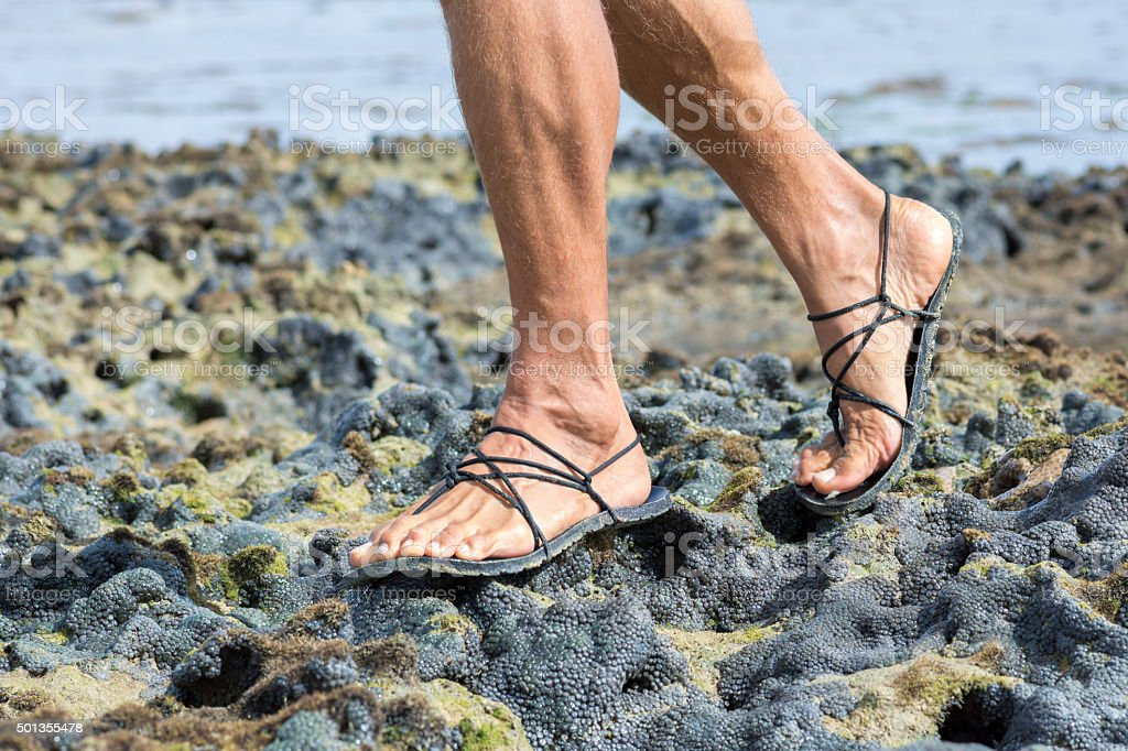 Walking in sandals on coral reef stock photo