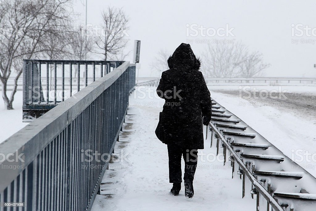 walking in snow stock photo