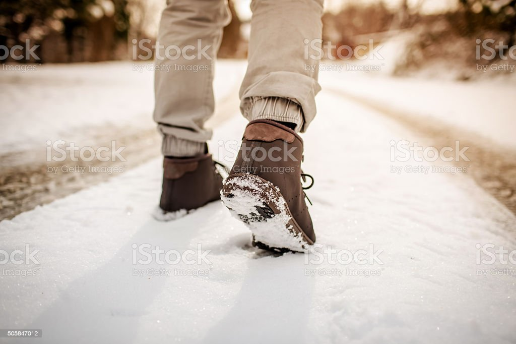 walking in the snow stock photo