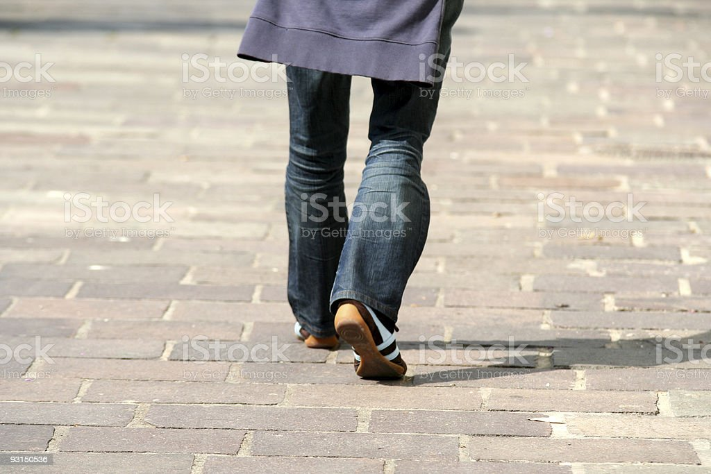 Walking in the street stock photo