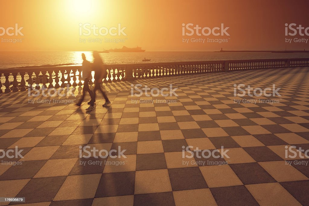 walking in the sunset royalty-free stock photo