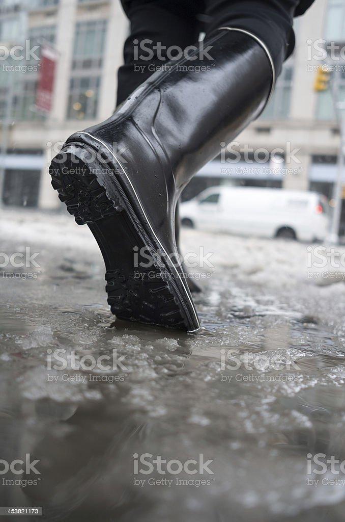 walking in winter slush stock photo
