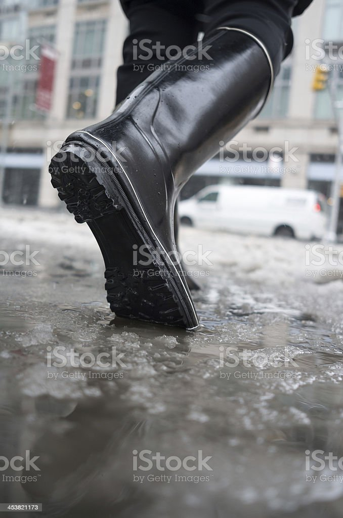 walking in winter slush stock photo