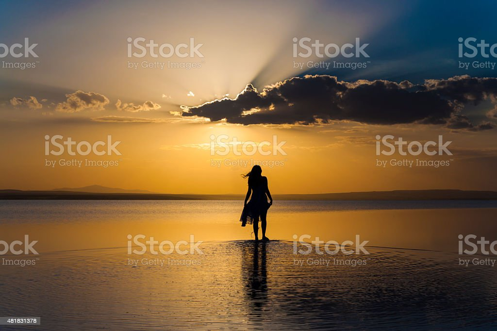 Walking into sunset stock photo