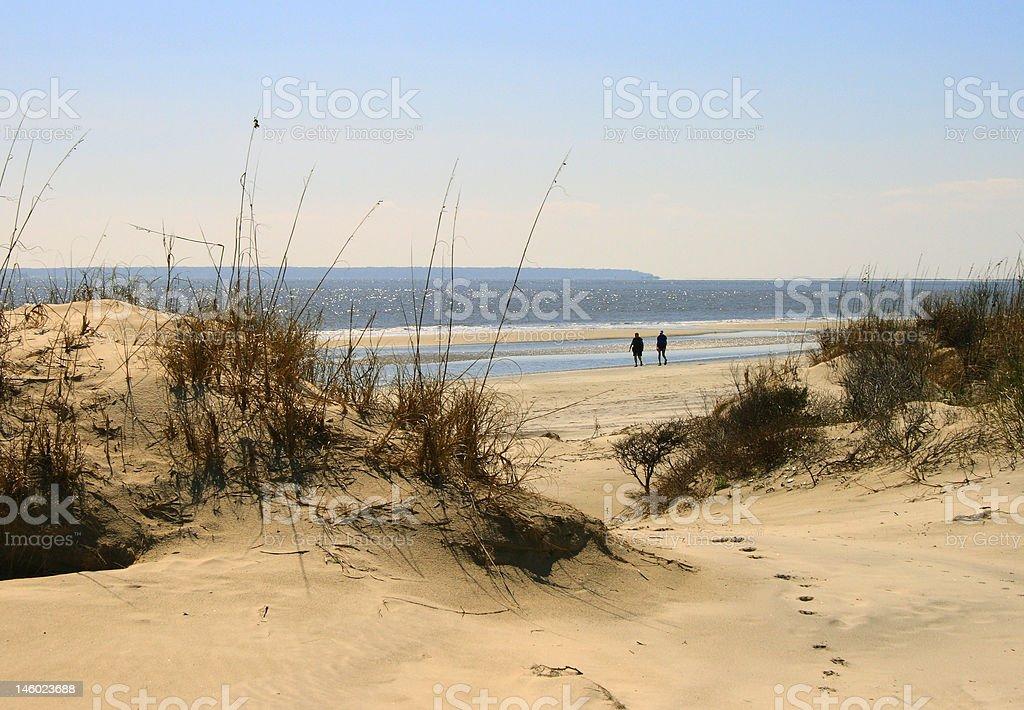 Walking Jekyll Island Beach stock photo