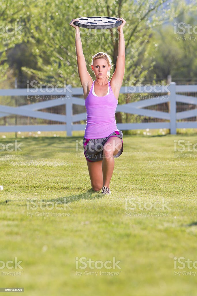 Walking Lunge with Wieght Plate Overhead royalty-free stock photo