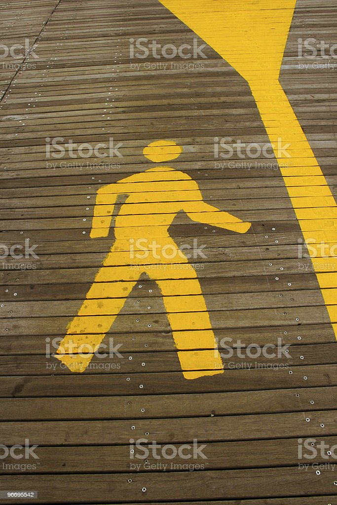 Walking man symbol indicates pedestrian lane. royalty-free stock photo