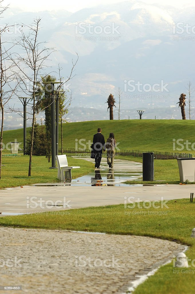 walking of couple in the park royalty-free stock photo