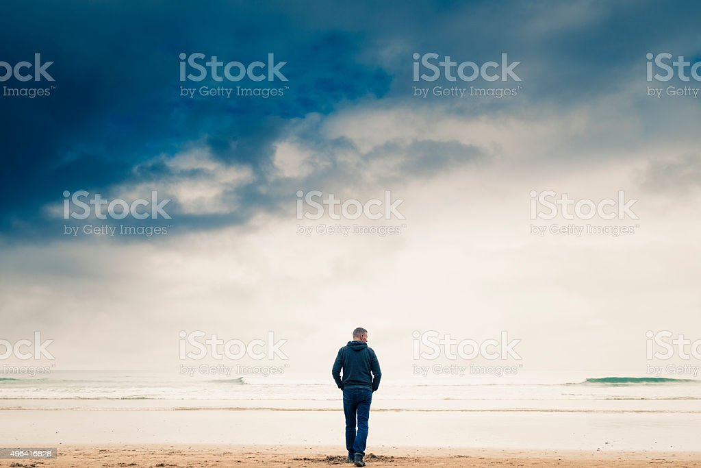 walking on a beach stock photo