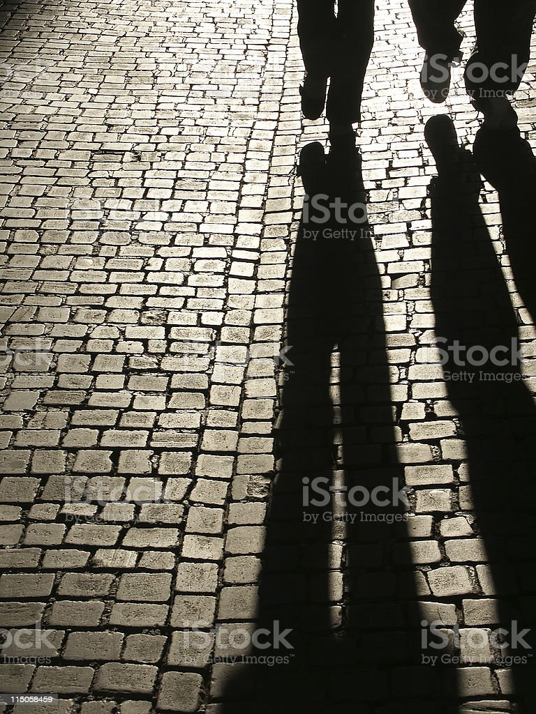 Walking on a cobbled street stock photo