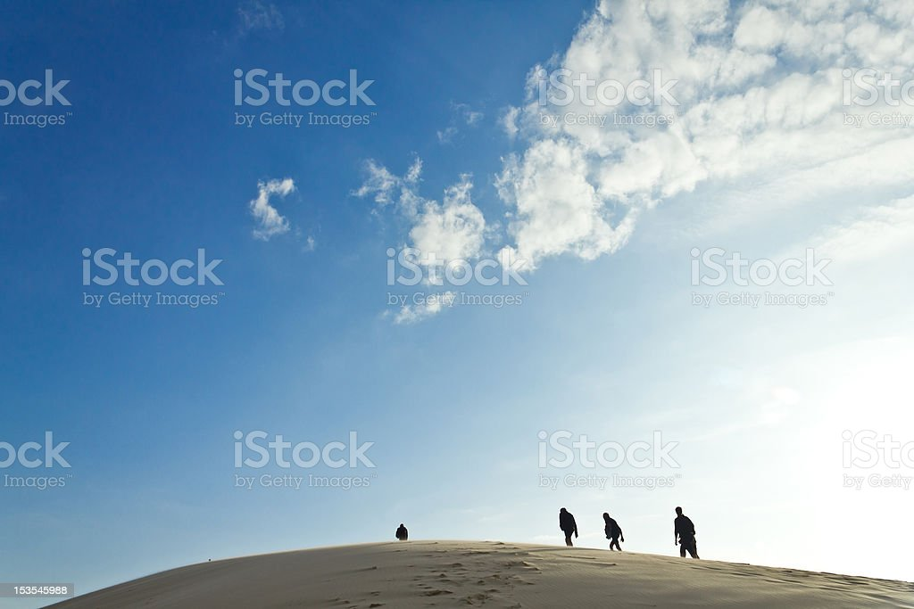 walking on a desert dune royalty-free stock photo