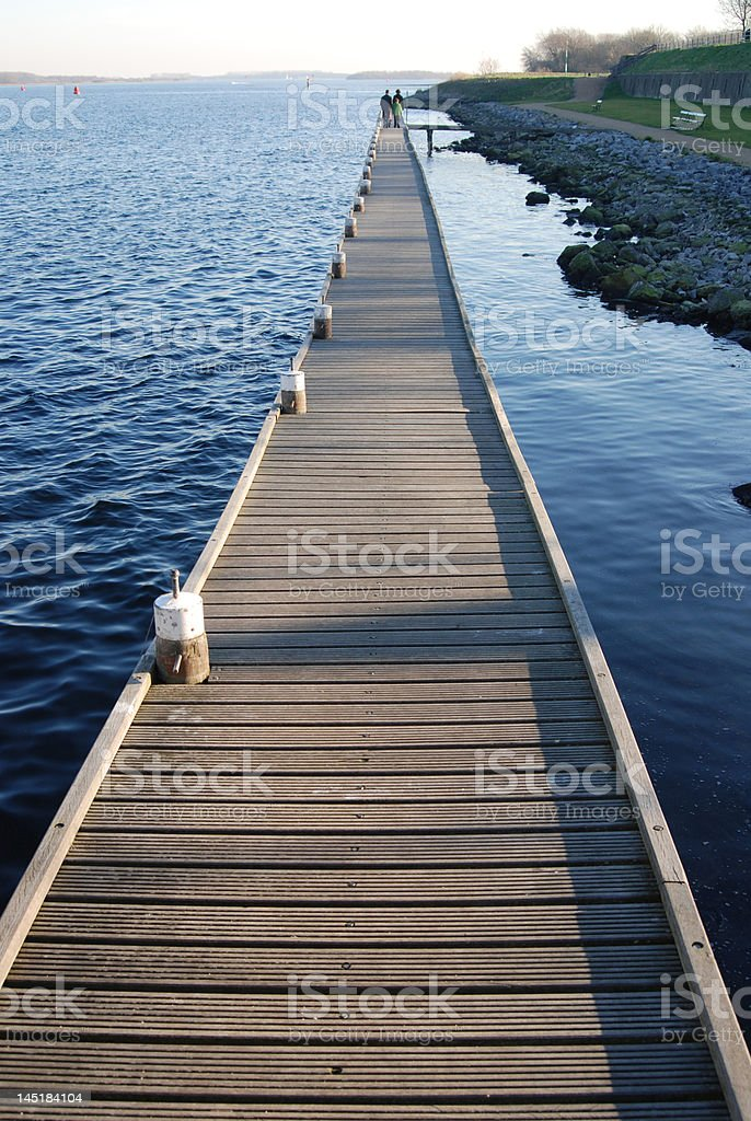 Walking on a pier royalty-free stock photo