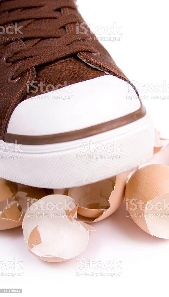 Walking on eggshells stock photo
