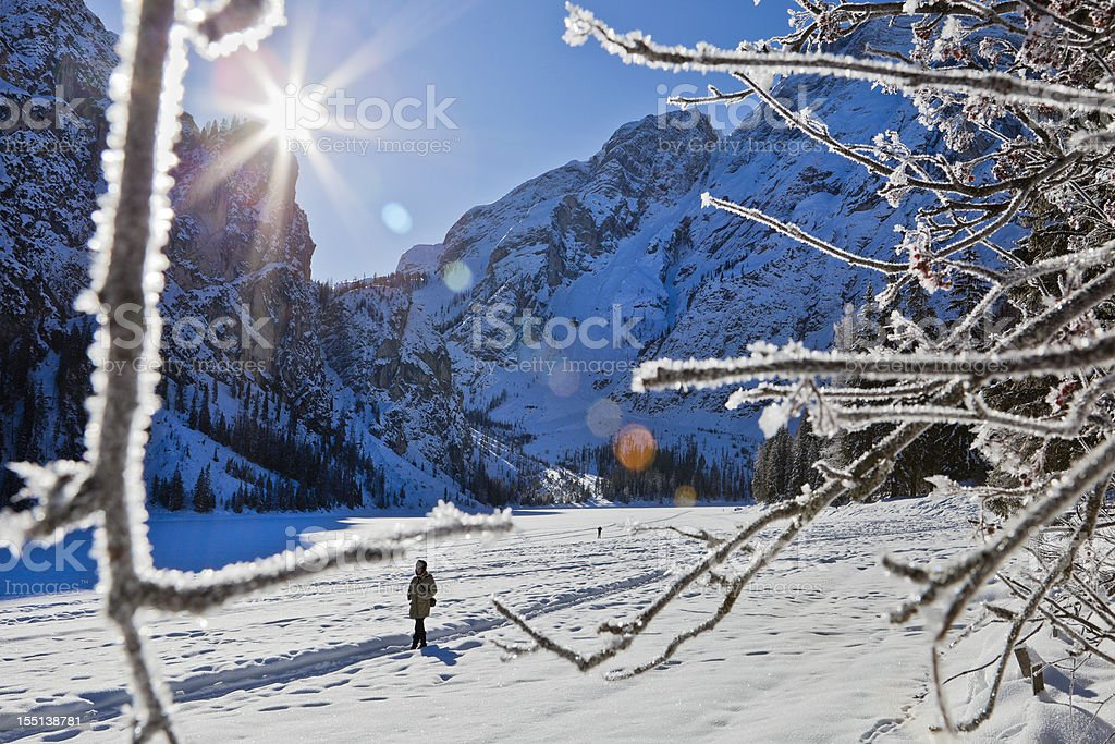 Walking On Frozen Lake Braies, Italy stock photo