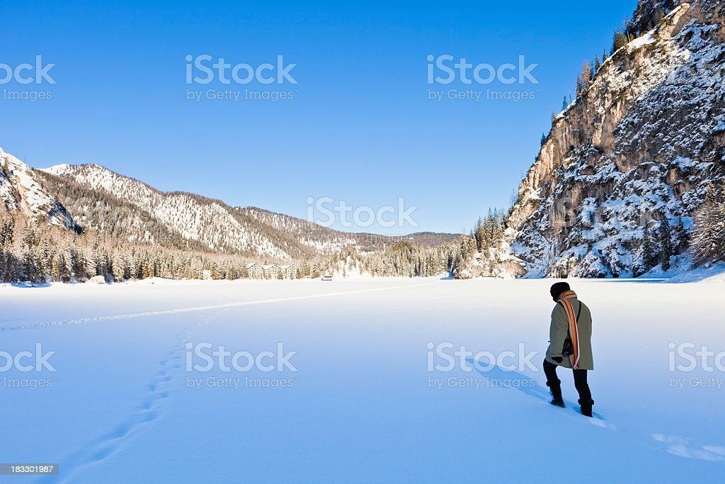 'Walking On Frozen Lake Braies, Italy' stock photo