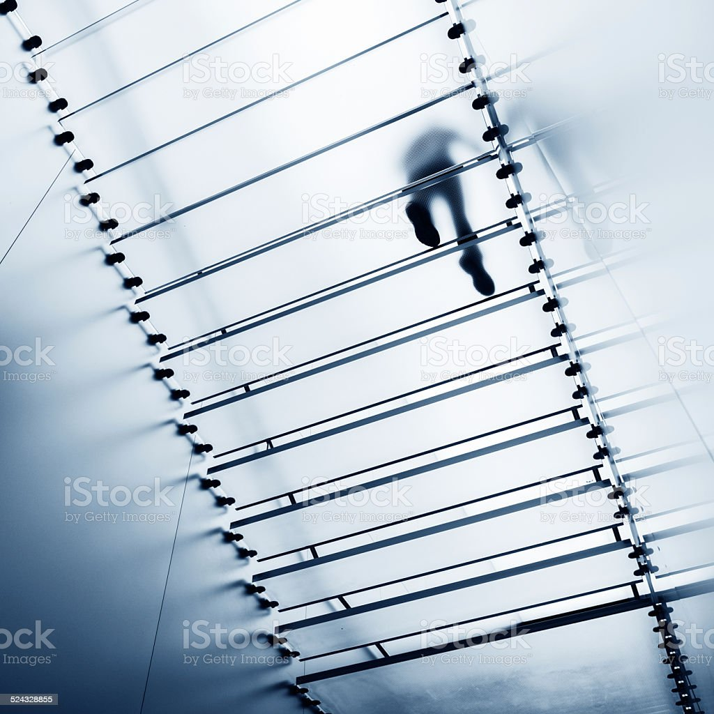 walking on glass staircase stock photo