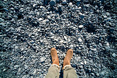 Walking on Lava pebbles in Iceland