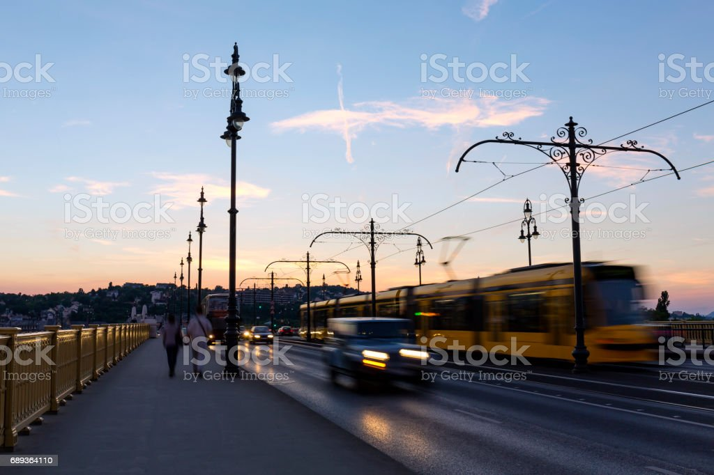 Walking on Margaret Bridge in Budapest at sunset stock photo
