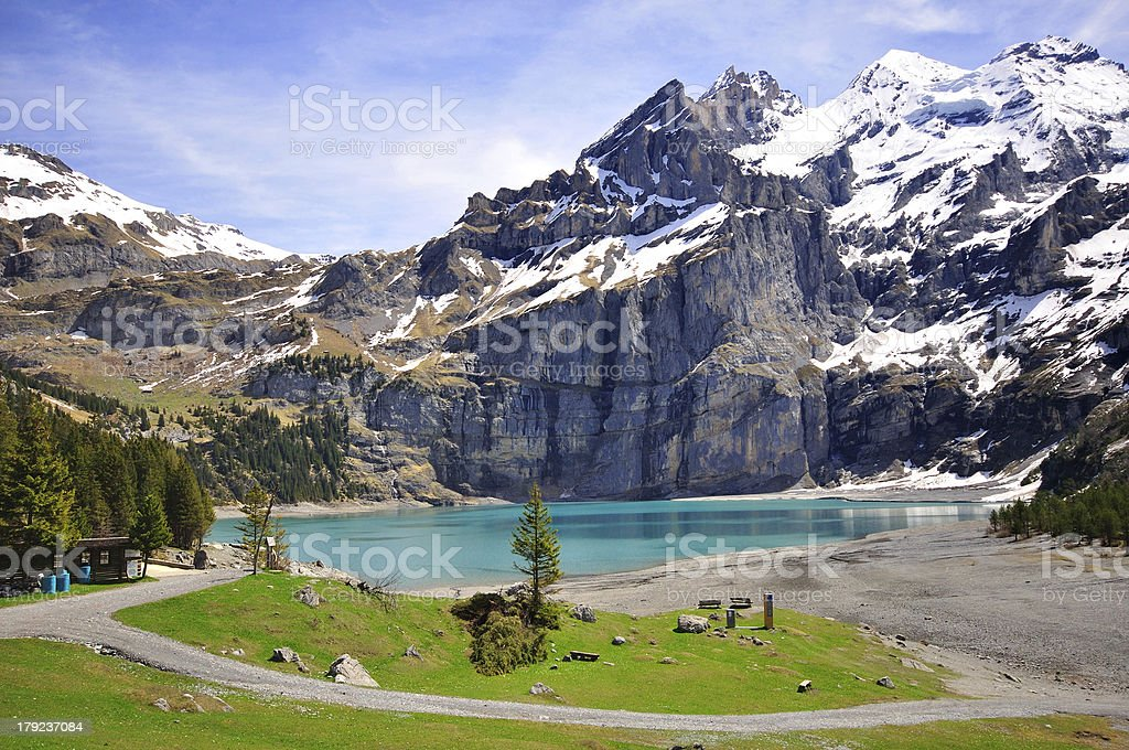 Walking on mountain and Lake Oeschinensee royalty-free stock photo