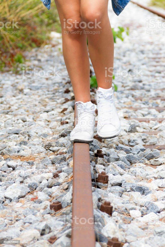 Walking on Rail stock photo