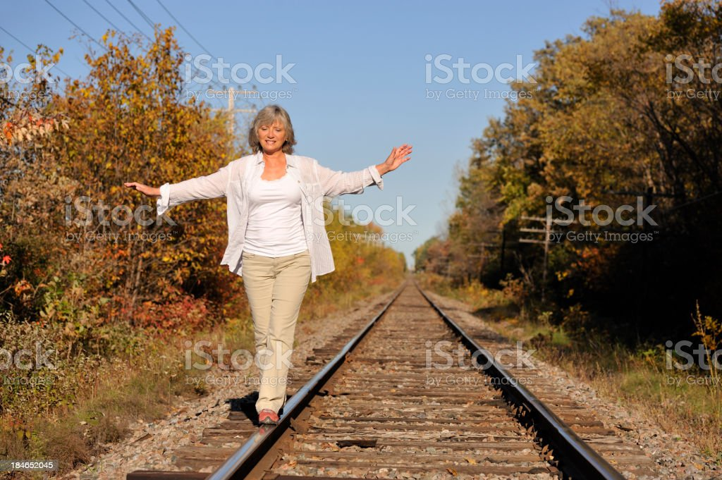 Walking on railroad track royalty-free stock photo