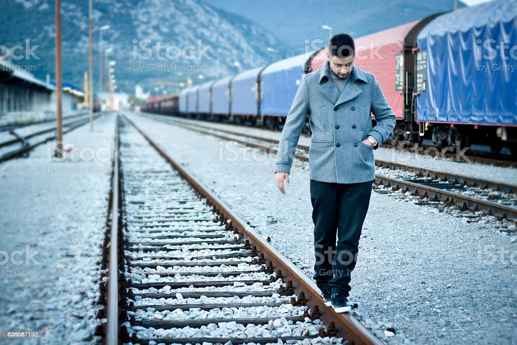 Walking on railroad track stock photo