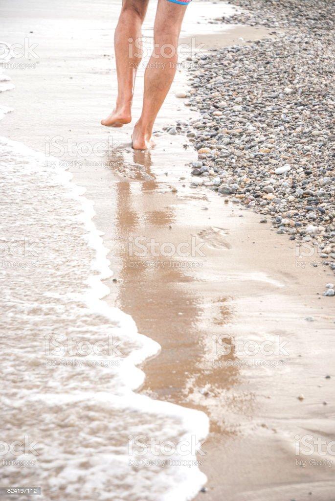 Walking on Sandy Beach Barefoot stock photo