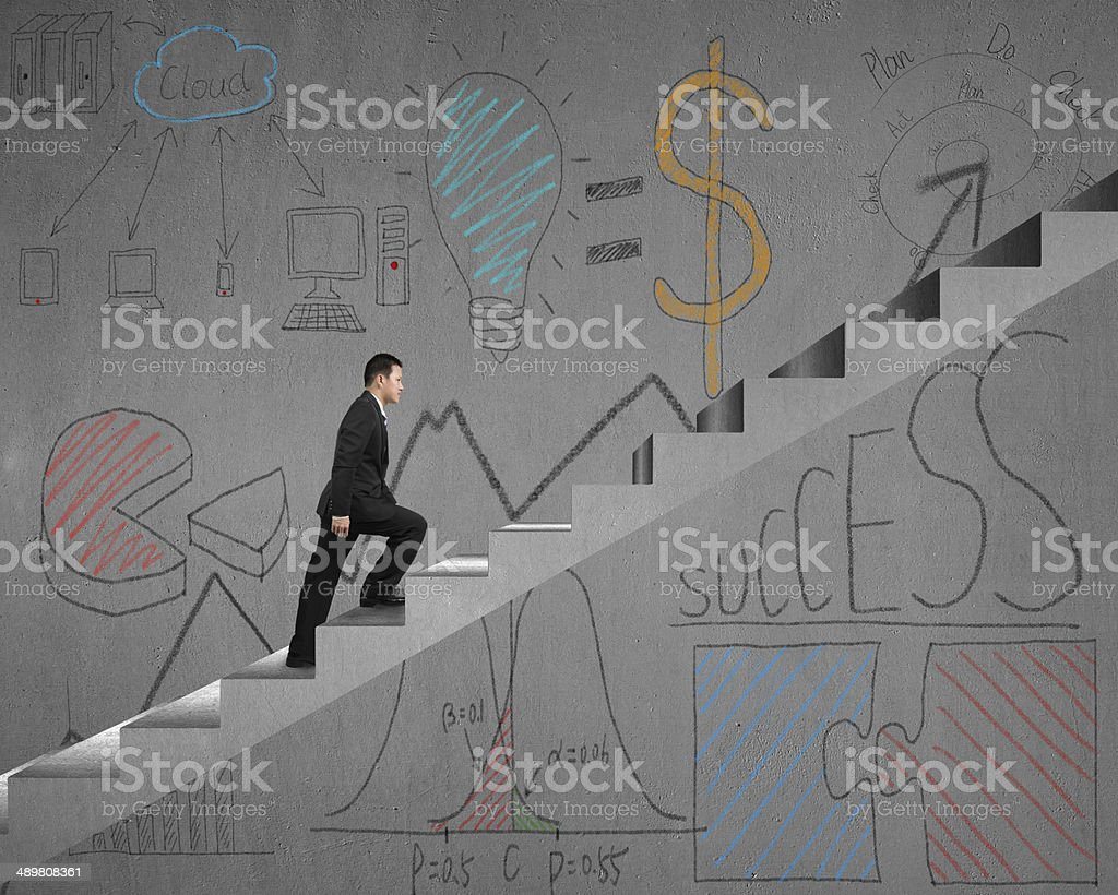 Walking on stairs with business doodles stock photo