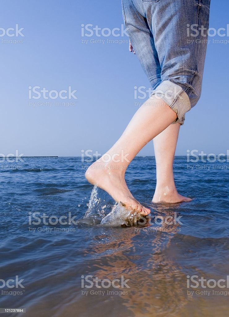 walking on the beach stock photo