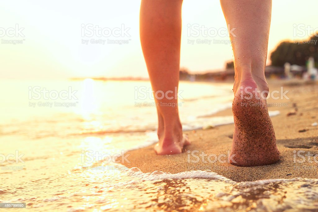 Walking on the beach. stock photo